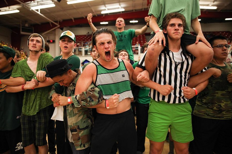Sophomore Joey LeSuer and his fellow Emerson Hall residents link arms to protect the women of Alpha for the last time in history at Nationball 2014. | Melanie Kim/THE CHIMES