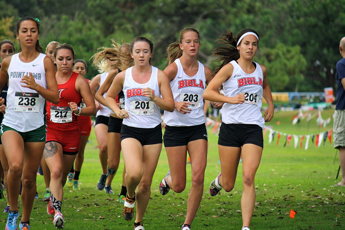 Junior Brooke Arvidson, freshman Stephanie Croy, and sophomore Lyndee Dawson run alongside other schools at the San Diego State Cross Country Invitational. The women's team took first place in the Invitational. | Courtesy of Allan and Jessi Kung