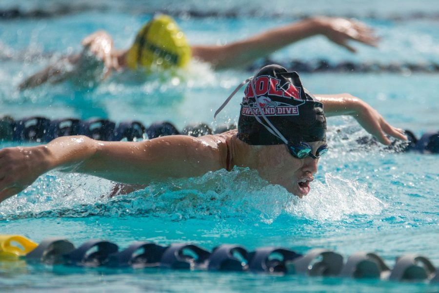 Freshman Lisa Tixier swims in the 100 yard butterfly at the Pacific Collegiate Swim and Dive meet of the season on Oct. 10-11. | Kalli Thommen/THE CHIMES