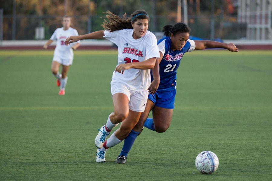 Freshman forward Samantha Verduzco battles for the ball against a William Jessup University player on Oct. 4. | Ana Waltschew/THE CHIMES