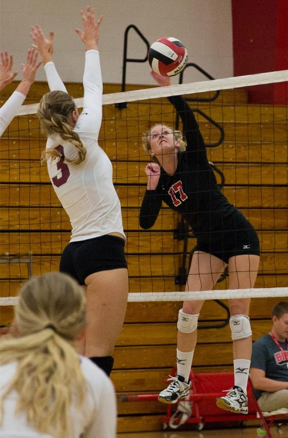 Junior right side hitter Crissy Cunningham spikes the ball down to Westmont College on Oct. 7. | Molli Kaptein/THE CHIMES