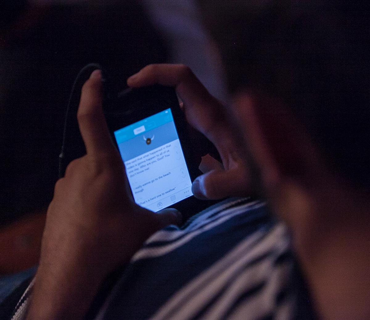 A Biola students updates his Yik-Yak app during Torrey Conference 2014. | Melanie Kim/THE CHIMES
