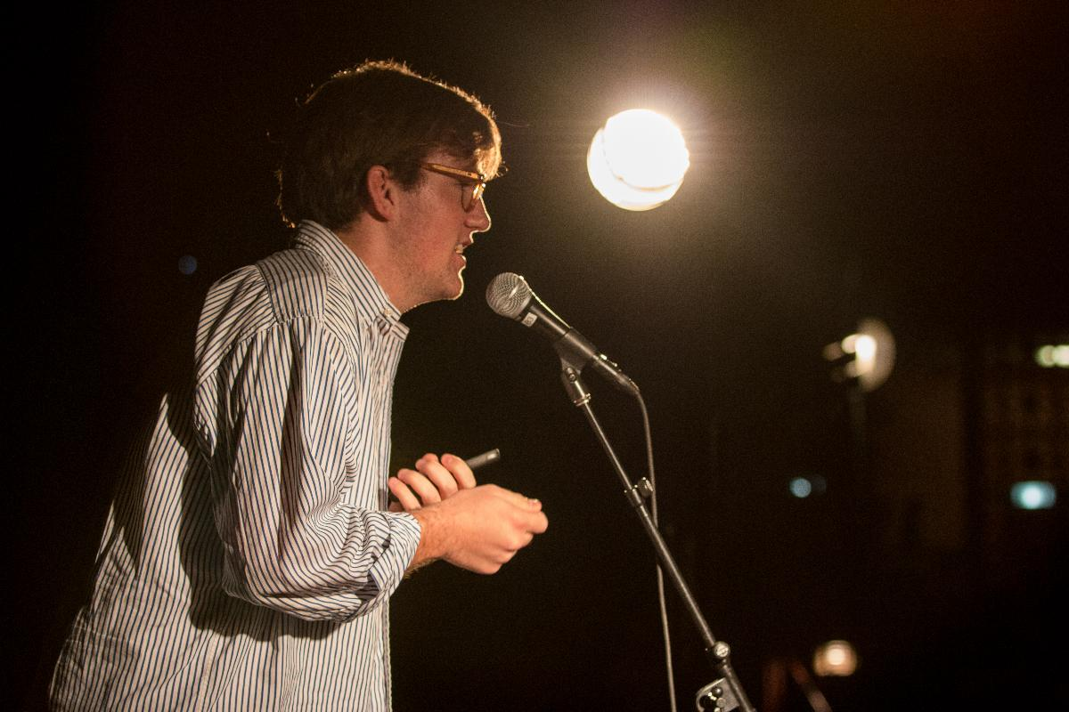 Senior communications major and AS music and arts coordinator Mark Nesbitt encourages students to participate and share original poetry pieces during Prayer Through Poetry on Oct. 30. | Katie Evensen/THE CHIMES