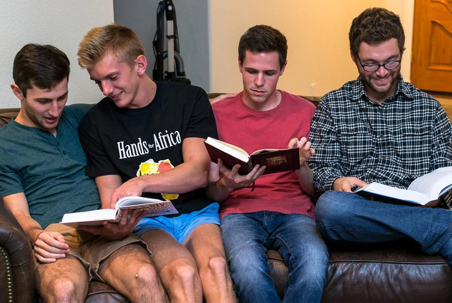 Junior biblical studies majors Charlie Plump, Jeff Sholar, Benjamin Crellin and Connor Stone study together in their home.   Kalli Thommen/THE CHIMES