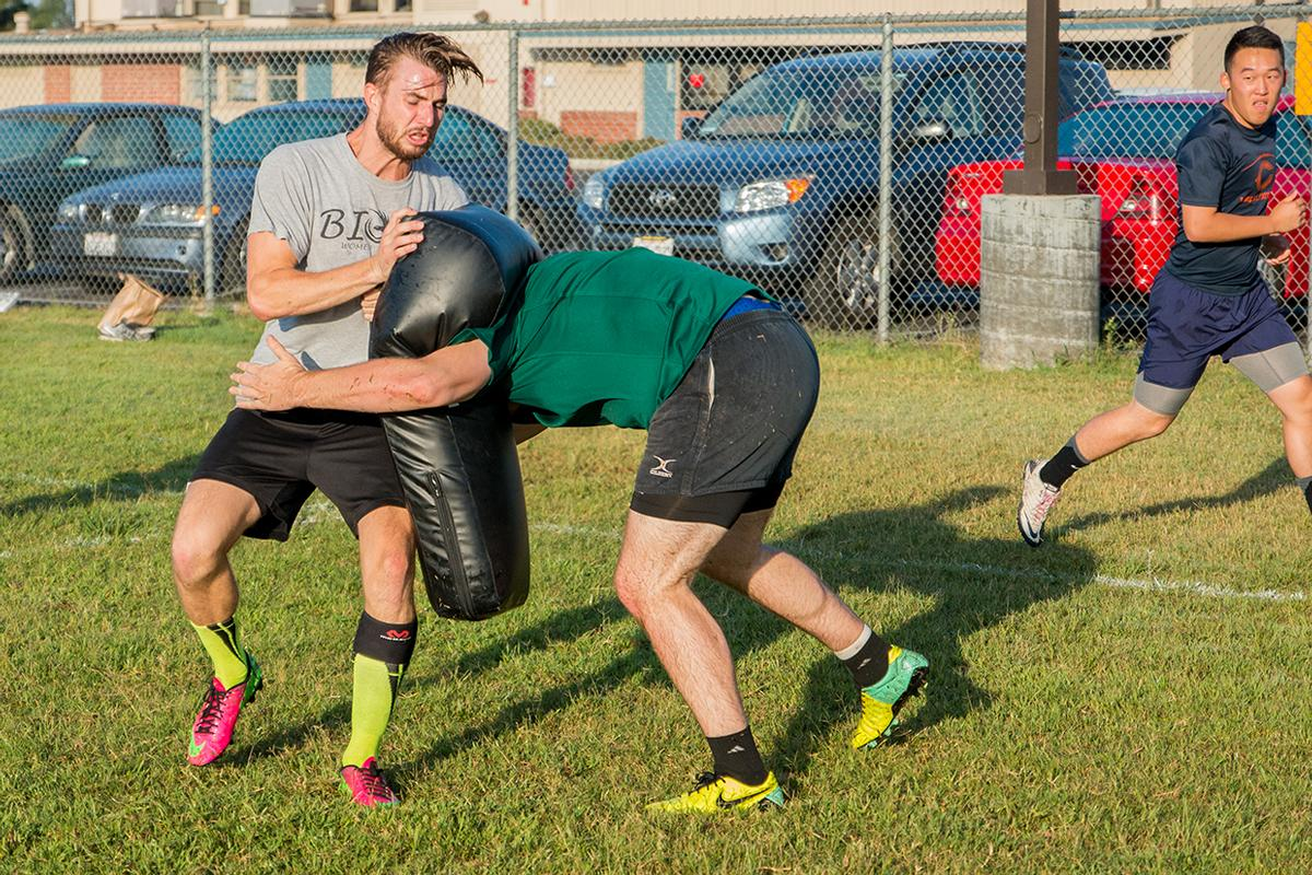 Senior Brock McNeff is tackled by a teammate during rugby practice. | Aaron Fooks/THE CHIMES