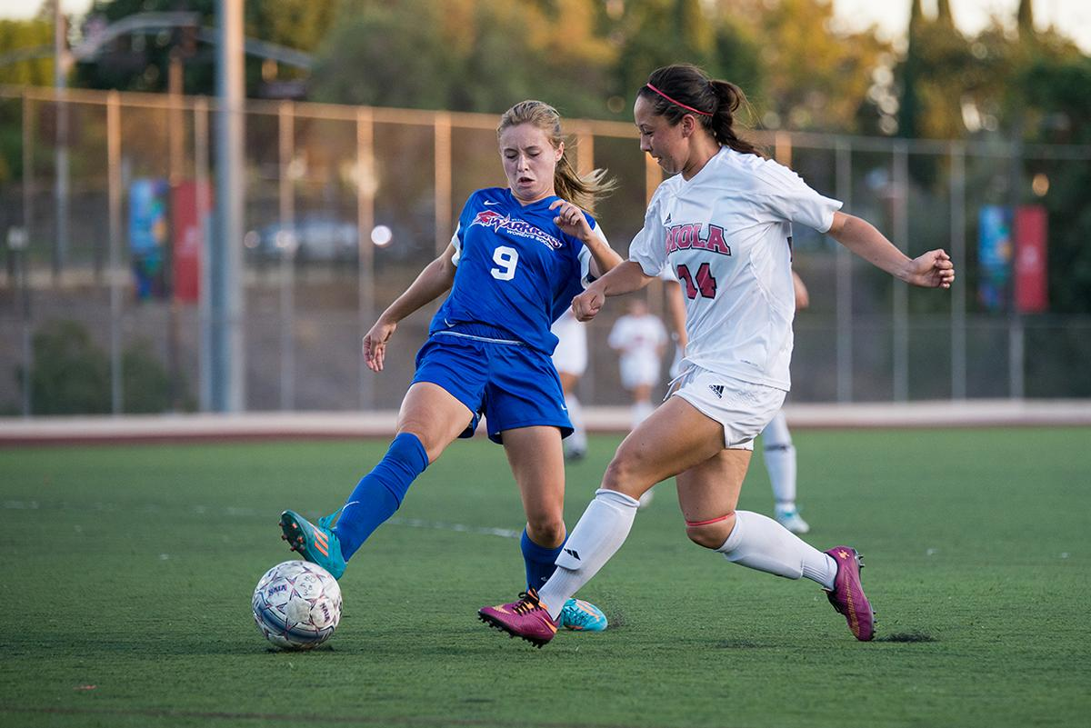 Senior midfielder Amanda Lillicrop lunges to steal the ball at the game against William Jessup University. Lillicrop scored two goals at the game on Oct. 4 and helped the team to win the game with a score of 3-1. | Jenny Oetzell/THE CHIMES