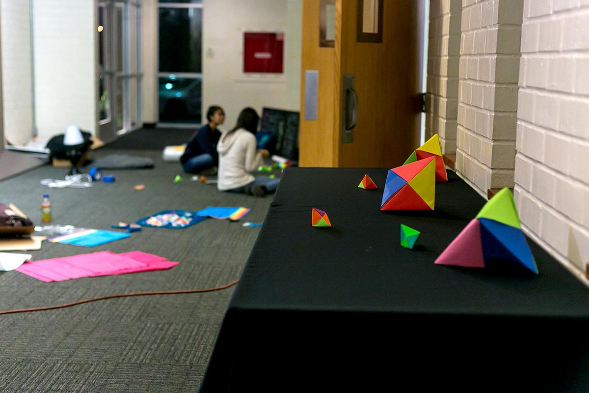 Students help make and set up decorations for Torrey Conference 2014 in Sutherland auditorium.   Anna Warner/THE CHIMES