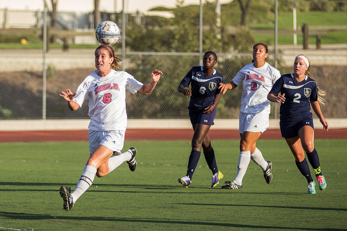Senior midfielder Miranda Starbeck heads the ball at the game against San Diego Christian College on Oct. 22. | Katie Evensen/THE CHIMES