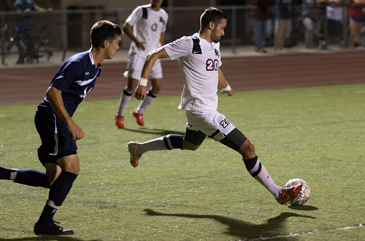 Junior forward Stephen Tanquary kicks the ball away from a San Diego Christian College player on Oct. 22.
