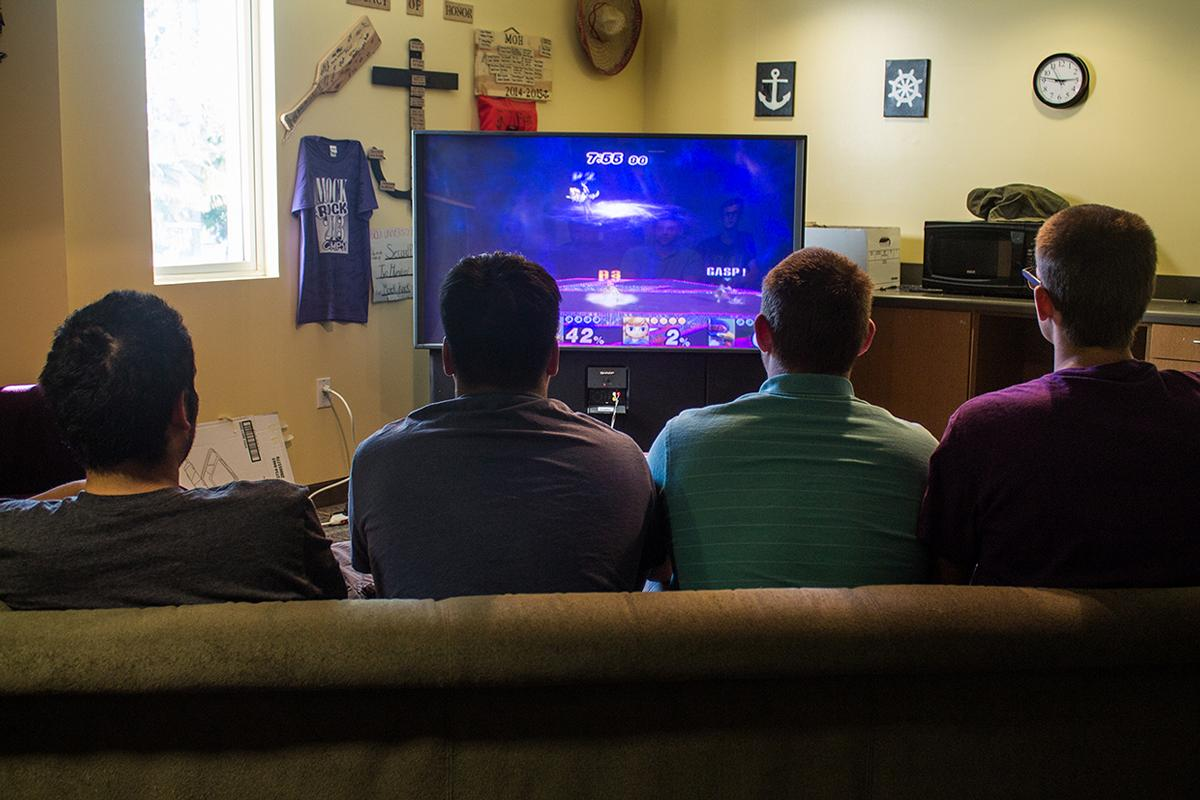 From left to right, freshman Matthew Martinez, Chazz Young, Trevin McConnell, and Dale Fredricks play video games in Horton Hall.   Katie Evensen/THE CHIMES