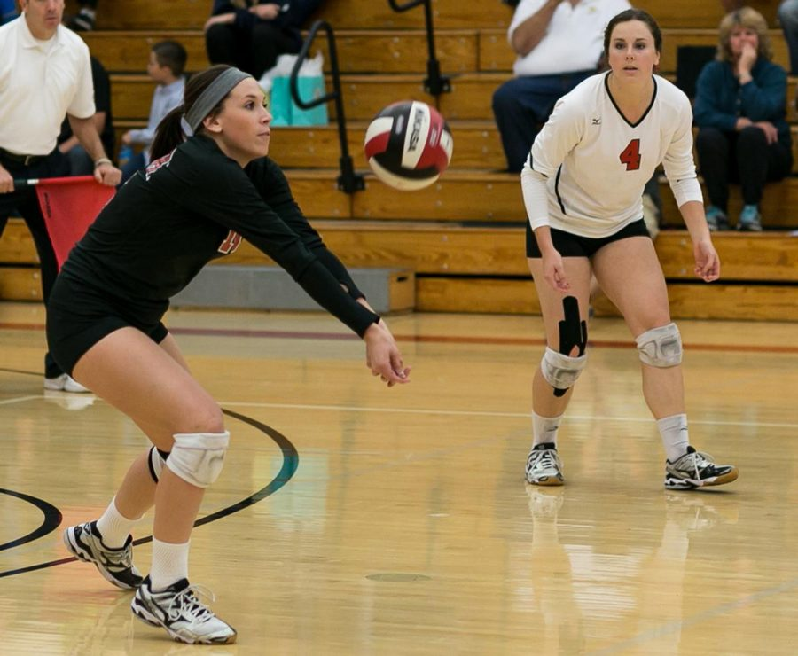 Senior libero Charley Parker bumps the ball at the game against San Diego Christian last season. | Anna Warner/THE CHIMES [file photo]