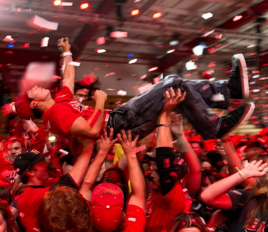 Junior business major Aaron Chavez is held up by the crowd at Midnight Madness last year.