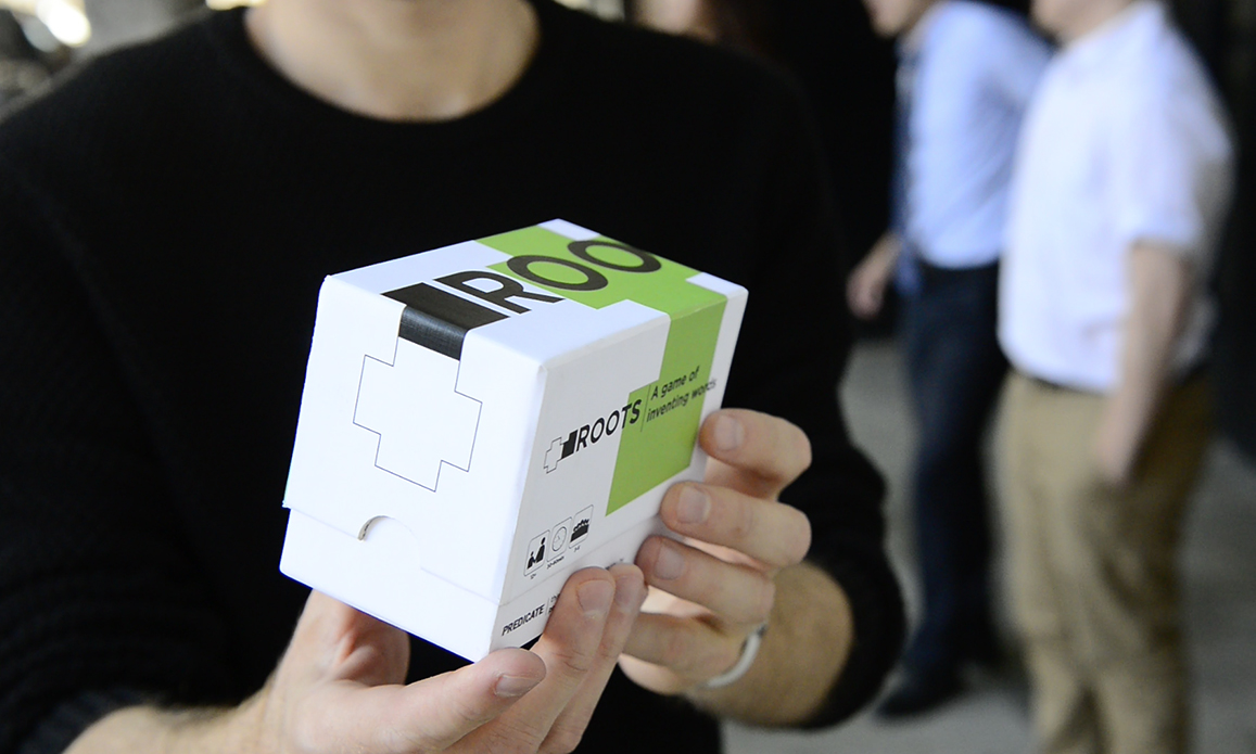 The outside packaging of the Roots game is shown. The game was lead by Talbot philosophy student Joe Ko.