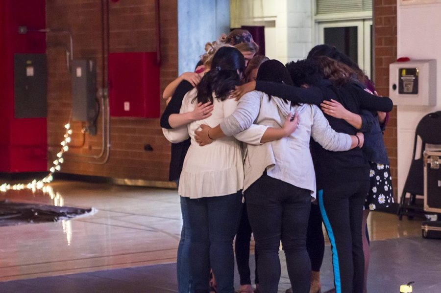 The conference staff gather together in prayer before the event begins.  |   Marika Adamopoulos/THE CHIMES