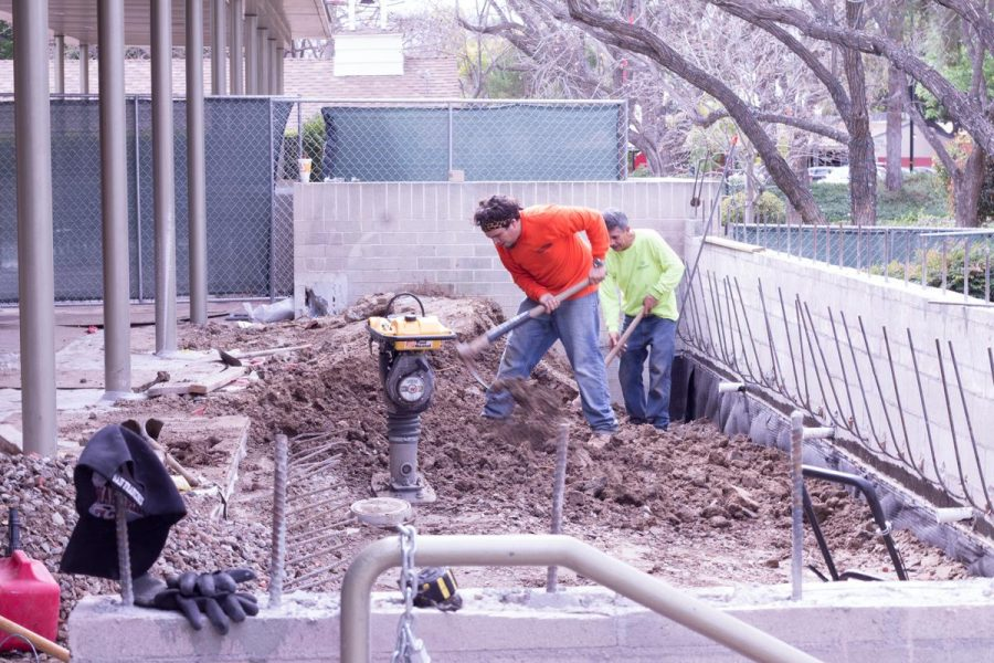 Construction crew members hard at work to complete the Heritage Cafe ahead of schedule. | Molli Kaptein/THE CHIMES