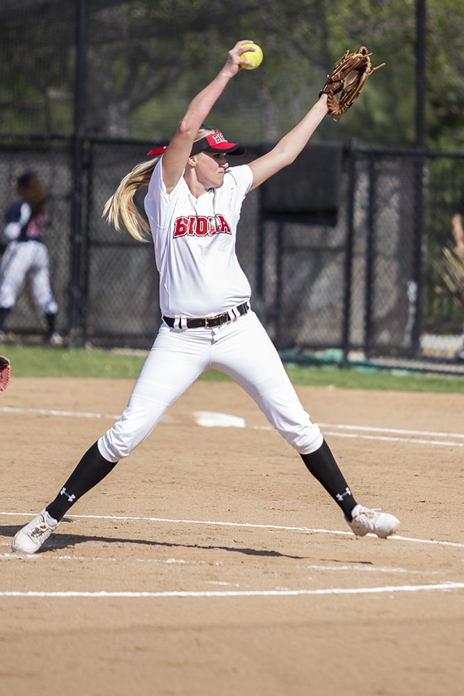 Freshman Terri Van Dagens setting up her pitch during the softball game on Feb. 17. | Molli Kaptein/THE CHIMES