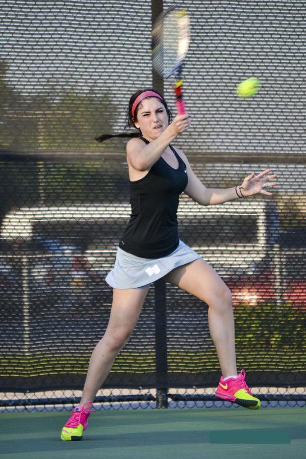 Junior Kathryn Ashford slams the ball during her singles match against Arizona Christian University on Feb. 6.   Ashleigh Fox/THE CHIMES [file photo]
