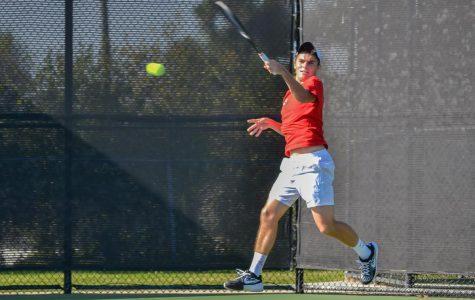 Men's tennis splits matches