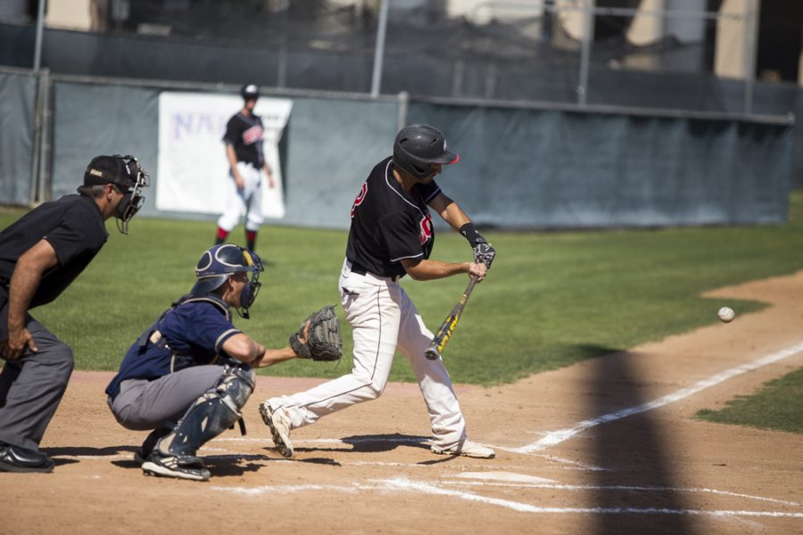 Senior Andy Smith swings at a pitch from San Diego Christian College on April 17. The baseball team finished their season this week. | Cherri Yoon/THE CHIMES [file photo