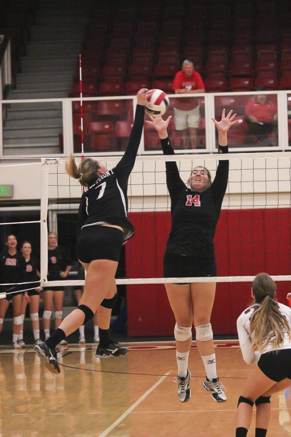 Senior Britta Blaser leaps high for ball in the game on Sept. 22. | Olivia Plew/THE CHIMES