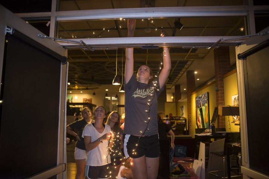 Torrey Conference 2015 volunteers help set up lights in the SUB Monday night before the start of the conference Tuesday morning.   Marika Adamopoulos/THE CHIMES