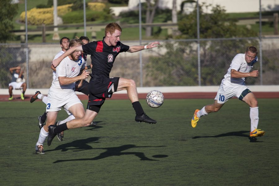 Senior John Hanscom leaps for the ball, stealing it from his opponent.   Matthew Maitz/THE CHIMES