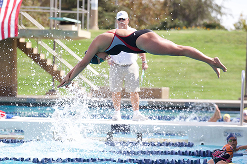 Freshmen break school records as several swimmers qualify for nationals.