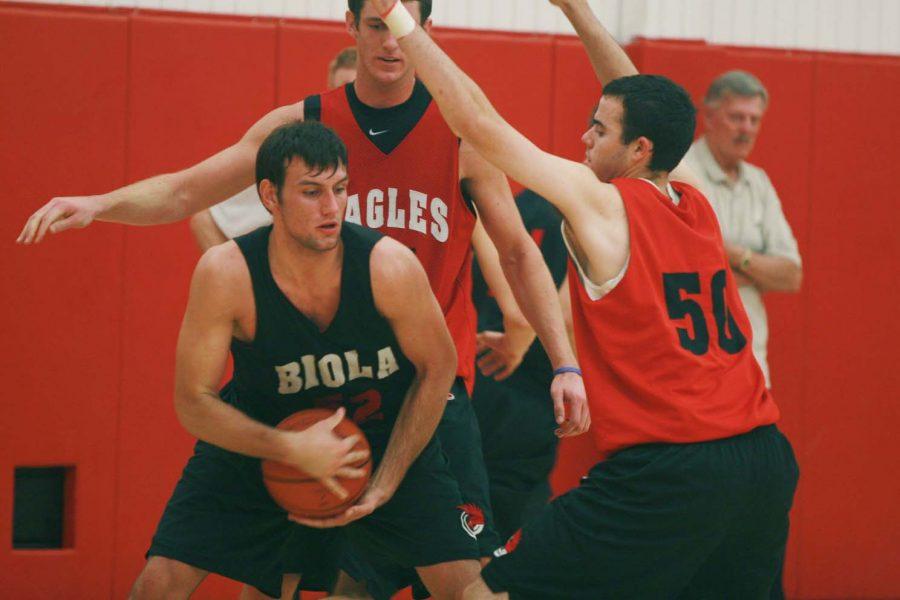 Sophomore Rocky Hampton (52) guards the ball during practice. Hampton plays forward on Biola's men's basketball team.
