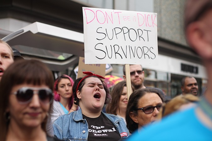 Survivor%27s+marchers%2C+one+holding+a+sign%3A+%22Don%27t+be+a+dick.+Support+survivors.%22