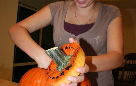Alyssa Morales of Hope works on carving a pumpkin for Friday's contest.