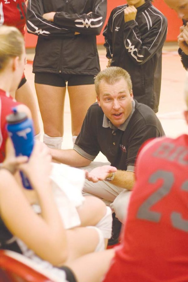 Coach+Aaron+Seltzer+encourages+the+ladies+volleyball+team+on+their+Tuesday+matchup+with+rival+Azusa+Pacific.+The+team+won+the+game.