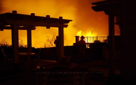 Flames inch towards homes in Portola Hills on Monday night.