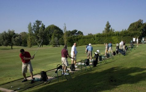Golfers practice at the driving range before the 29th annual Biola Golf Tournament, a fundraiser.
