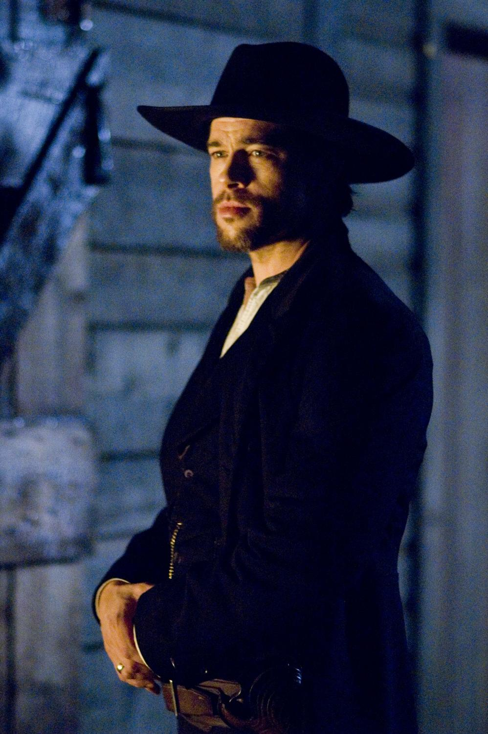 """Brad Pitt stars as the deadly outlaw Jesse James in """"The Assassination of Jesse James by the Coward Robert Ford,"""" playing in theaters now."""