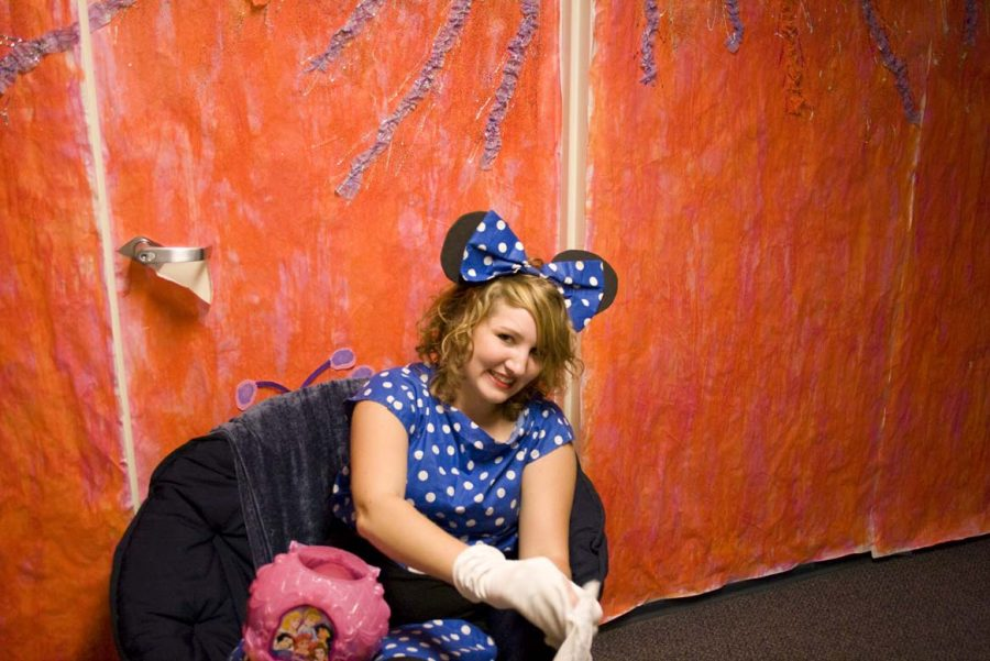 Freshman Hannah Pearsey, sat outside her giant gumdrop door at Alpha's Candyland event on Wednesday night. Dressed as mini mouse, she played Disney music and handed out candy to the trick-or-treaters.