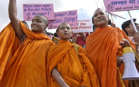 Nepalese Buddhist monks hold placards as they protest against the Myanmar military government in Katmandu, Nepal, Monday, Oct. 1, 2007.