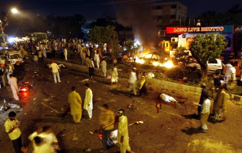 The scene of devastation caused by a bomb explosion at a procession of Pakistan's former Prime Minister Benazir Bhutto in Karachi, Pakistan on Thursday, Oct 18. Bhutto was unhurt.