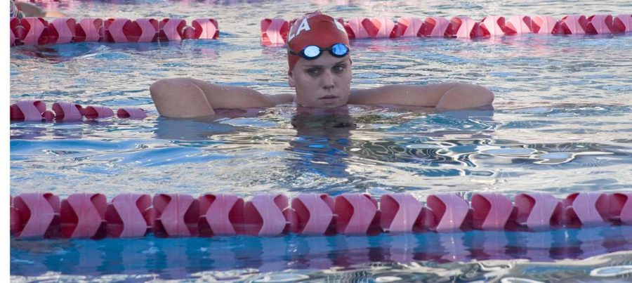 Freshman Hannah Lawman rests during practice. Lawman was one of several new natinoal qualifiers for the women's 200 breastroke.