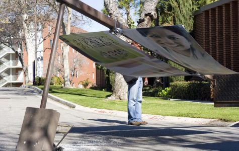A light pole displaying a diversity banner fell outside the cafeteria at 1:45 on Tuesday afternoon.