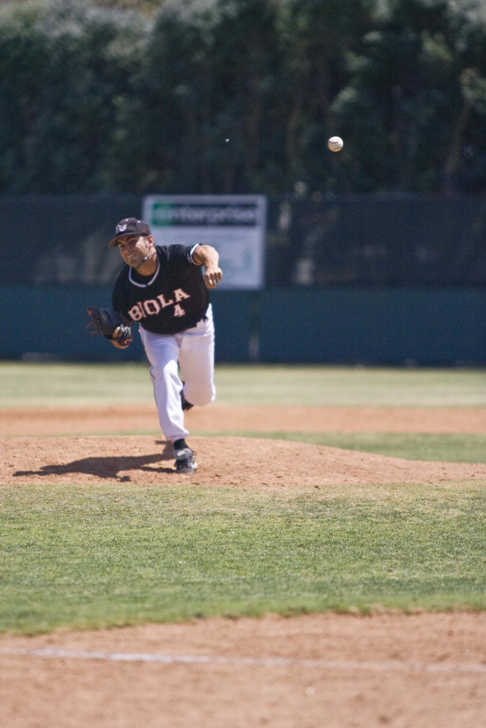Senior Jimmy Johnson pitches against Azusa Pacific in one of the last regular season games of 2008.
