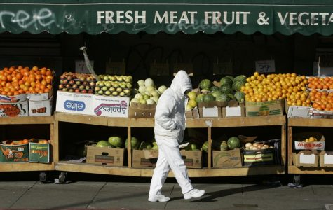 A man walks by a fruit stand on a chilly morning in San Francisco, Tuesday, Jan. 1, 2008.