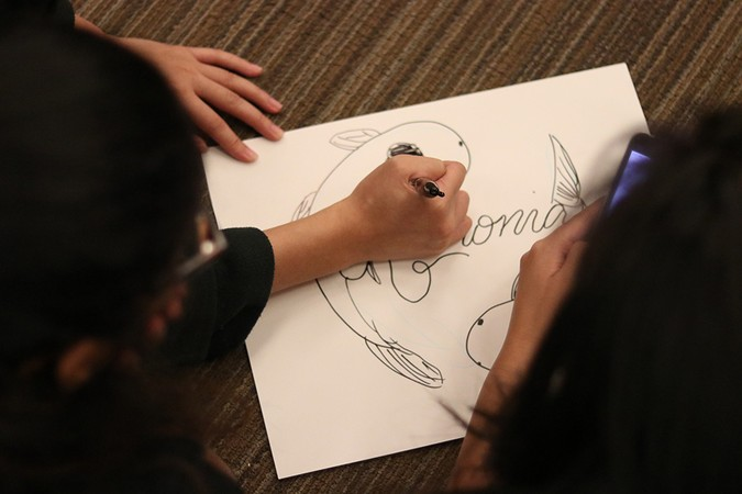 Global students created team logos during GSPD's first spring community group kickoff event.