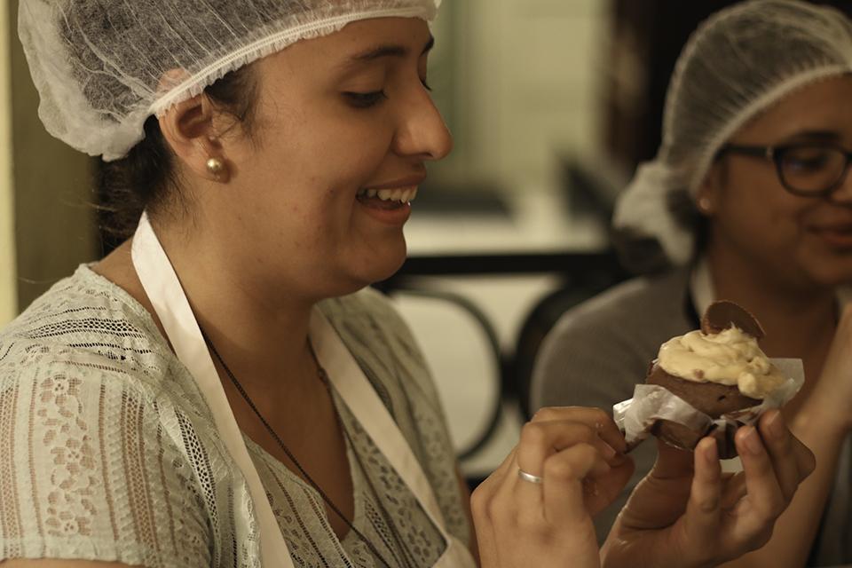 Senior nursing major Linda Venegas eats one of her cupcakes.