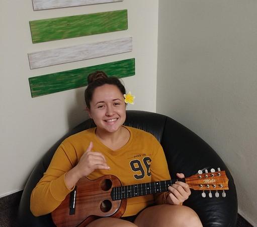 A picture of Beka Revelle holding an ukulele
