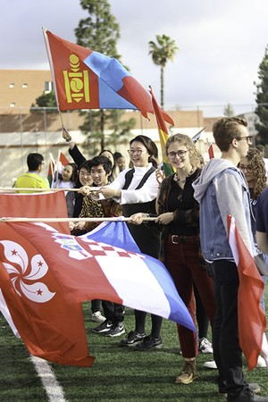 Students waving national flags