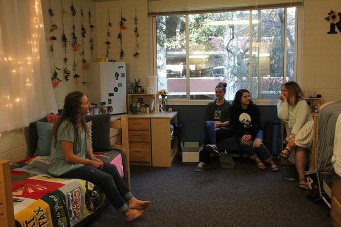 Students inside dorm room