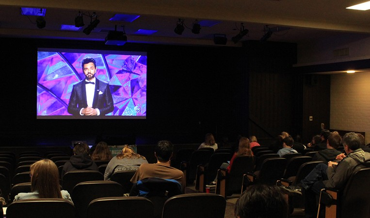 Students watch the 2018 Oscars on a projection screen