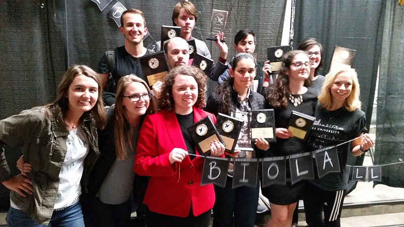 Members of the forensics team post with awards
