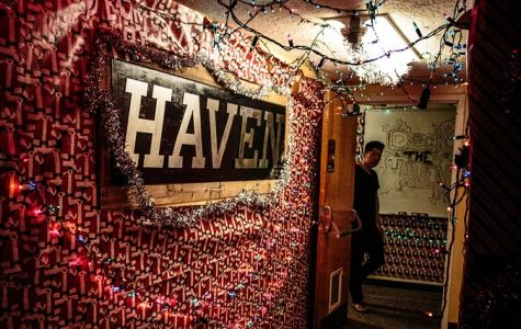 Haven resident and sophomore kinesiology major Anson Tjing gazes from his floor, decorat- ed for Deck the Haven 2015. This year's event will take place in a tent near Fluor Fountain after surviving discontinuation.