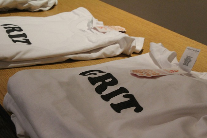 GRIT t-shirts lay on a table during the blog's public Christmas event.